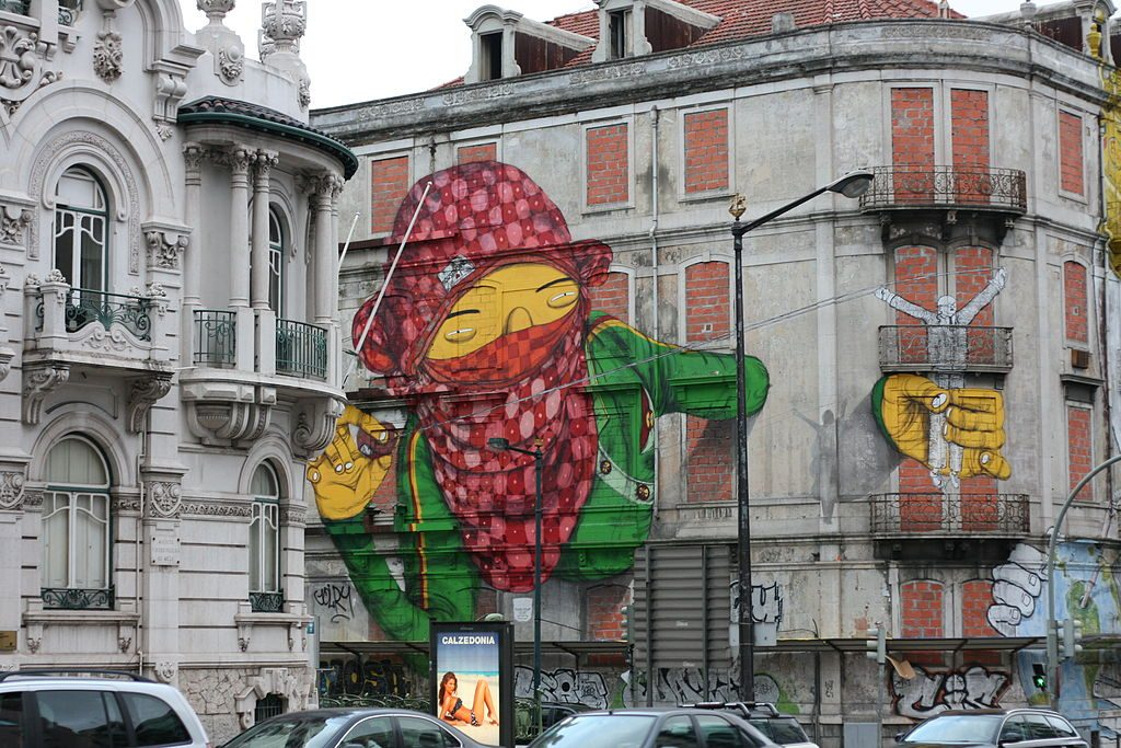 Œuvre d'Os Gemeos (Lisbonne, Portugal) / By Erdalito. (Own work) [CC BY-SA 3.0 (http://creativecommons.org/licenses/by-sa/3.0)], via Wikimedia Commons